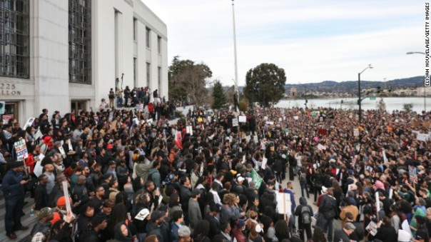 OAKLAND, CA - DECEMBER 13: Protesters congregate at the Alameda County Court House during a 'Millions March' demonstration protesting the killing of unarmed black men by police on December 13, 2014 in Oakland, California. The march was one of many held nationwide. (Photo by Elijah Nouvelage/Getty Images)