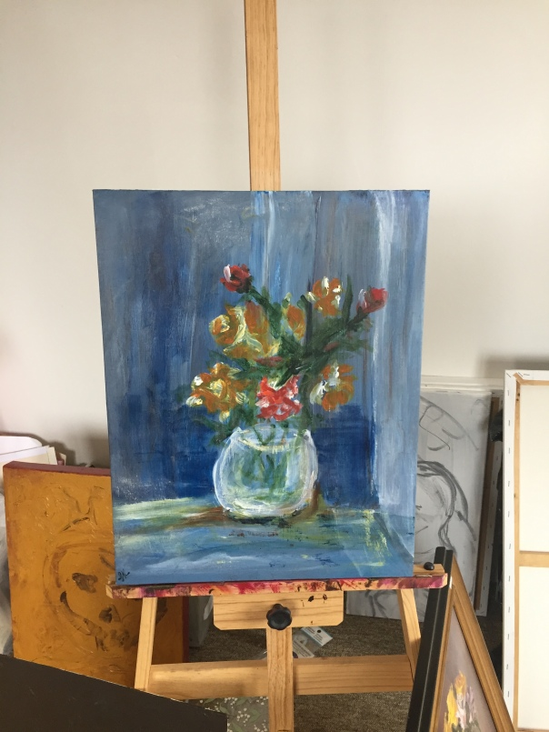 stil life in blue on easel